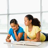Girls doing schoolwork.