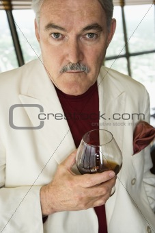 Man holding drink.