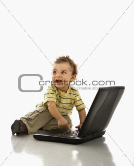 Baby using laptop.