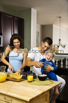 Family in kitchen.