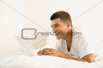 Man on computer.
