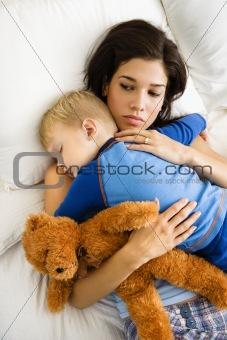 Mom with sleeping child.