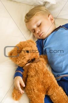 Baby sleeping with bear.