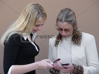 Blond women with phones