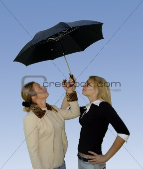 2 women under the umbrella