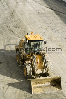 Freeway construction; bulldozer from above
