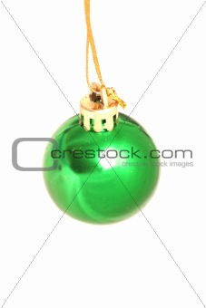 One green brilliant toy on a white background