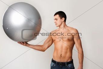 Man holds ball