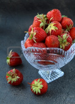 Antique glass vase with fresh tasty strawberries