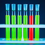 Six test tubes, one red