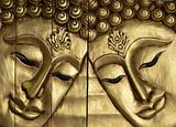 Double Buddha faces carved wood
