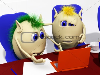Two puppets looking at laptop with sorrow