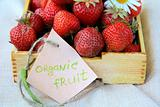 fresh ripe organic strawberries in a wooden box