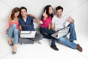 friends aprooving laptops smiling