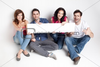 happy friends showing white banner