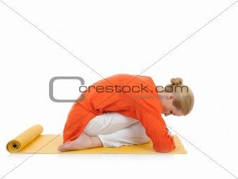 series or yoga photos.young woman in virasana pose