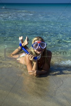 Young happy beautiful summer woman with swimming mask and snorkel