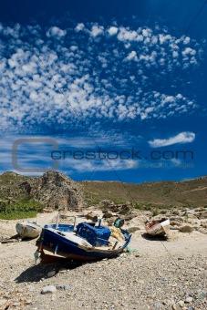 Rusty old boat on the shore in Greece island Crete