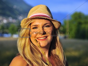 Beautifu summerl female portrait with hat and wheat outdoors