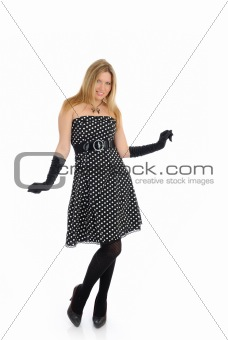 Beautiful sexy woman in elegant dress standing. studio shot