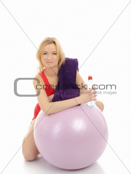 Pretty fitness woman doing exercise with pilates ball. isolated