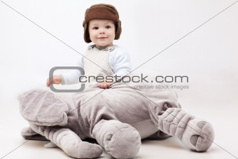 adorable baby holding elephant toy