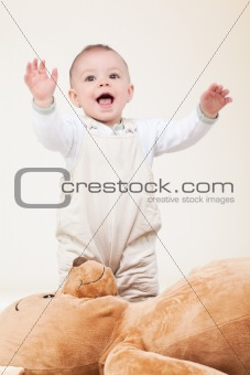 adorable baby with bear toy