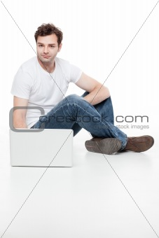 man sitting behind blanck laptop
