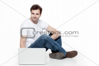 casual man sitting behind laptop