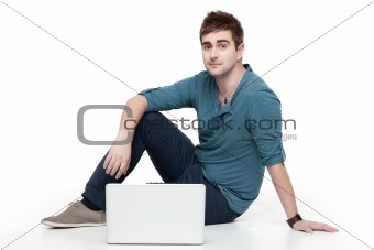 young man sitting behind laptop