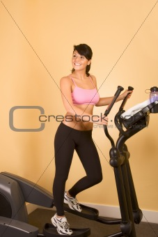 Attractive young sweat woman doing cardio workout