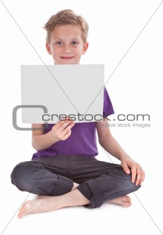 boy sitting and holding a blank white page