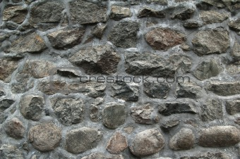 Fragment of a wall laid out from a granite