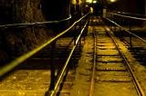 Railway in abandoned mine with yellow lights