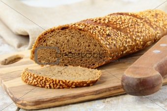 baguette rye  black bread on a wooden board