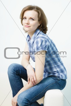 attractive young girl sitting on the couch home