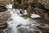 small waterfall in winter