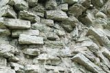 Fragment of a wall from a calcareous stone, a background