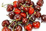 Fresh ripe cherries isolated on white background