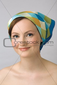 Portrait of young girl in kerchief.