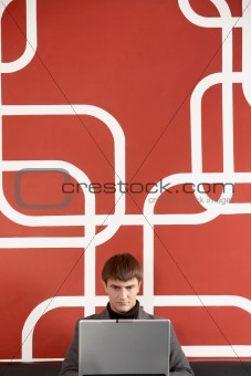 Businessman by the wall