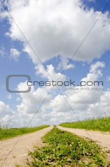countryside road with summer clouds