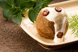 Baked potato with sour cream, greaves and fresh dill