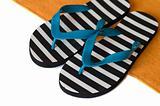 Flip-flops and towel