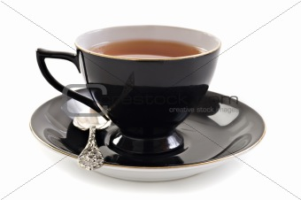 Black tea cup on white