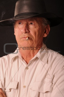 Old smoking cowboy