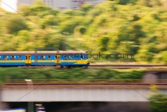 blue and yellow fast electric train