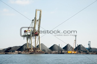 slag heaps of coal on the wharf in the port