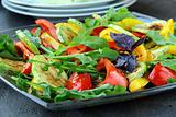 salad with grilled vegetables - capsicum peppers and zucchini with arugula