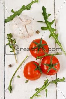 Tomatoes, arugula, garlic and thyme.